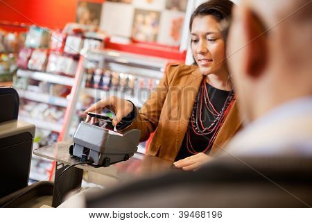Customer paying for purchase with mobile phone