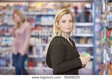 Portrait of young Caucasian woman shopping at supermarket