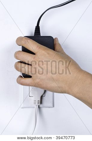 Plugging In Electrical Power Supply Into Wall Outlet