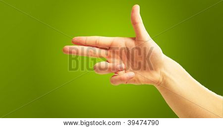 Human Hand Pointing With Two Fingers On Green Background