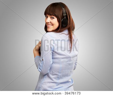 Happy Woman Wearing Headphone Isolated On Grey Background
