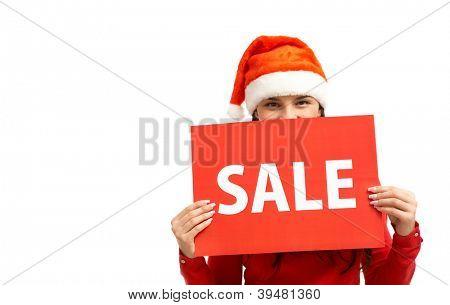Pretty girl in Santa cap announcing sale