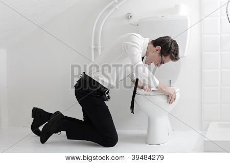 Young businessman screaming in a toilet