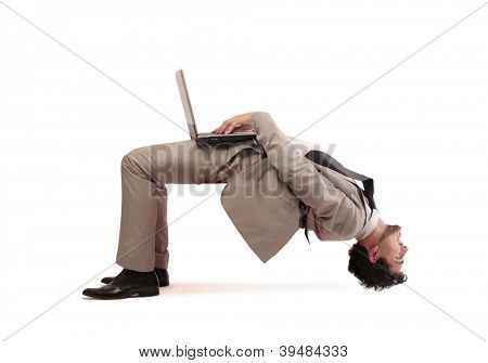 A man gets upside down while using a computer