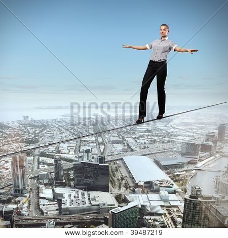 Balancing businesswoman and cityscape