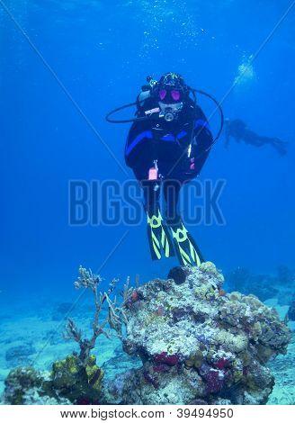 Woman scuba diver on reef in Cozumel