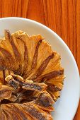 foto of skat  - Dried fish fried On  the brown wood - JPG