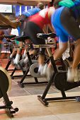 stock photo of exercise bike  - blur motion of group of people having a training session on bikes - JPG