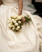 stock photo of tilt  - bride holding white rose bouquet shot with tilt - JPG