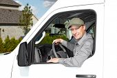 foto of movers  - Smiling truck driver in the car - JPG