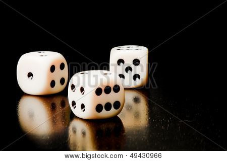 Three White Dice On Old Wood Black Table