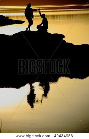 Man Making Marriage Proposal At Sunset