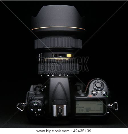 professional digital photo camera against black background
