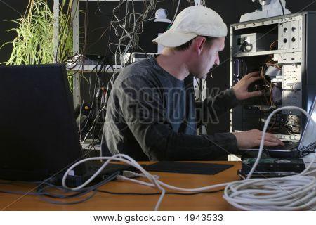 Man Repairs Computer