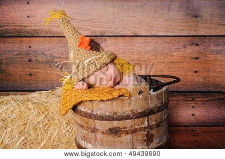 Newborn Baby Boy Wearing Scarecrow Costume