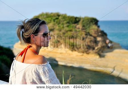 young woman admiring seascape