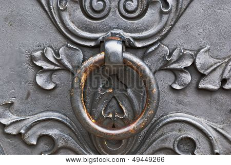 Closeup Of Metal Door With Metal Door Handle.