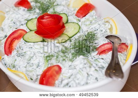 Greek salad made of vegetables and yogurt