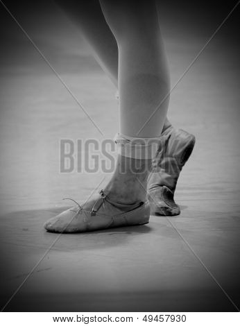 Dancer's Feet With Old Shoes And Bandage