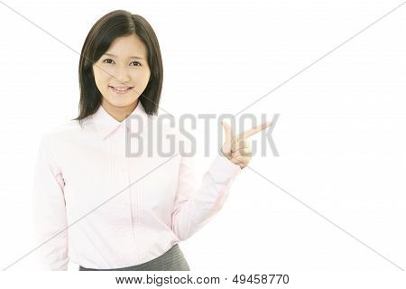 Young businesswoman pointing.