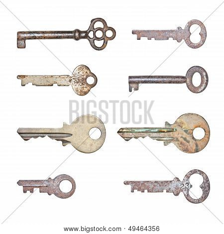 A Collection Of Rusty Old Keys In Isolated White Background.