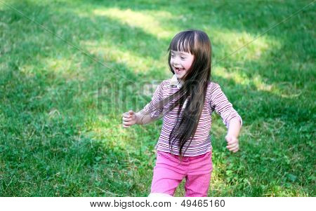 Portrait Of Beautiful Young Girl In The Park