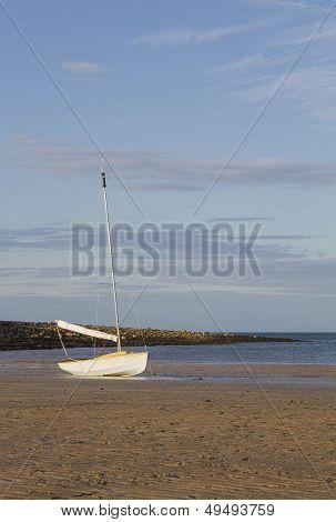 Small dinghy on beach