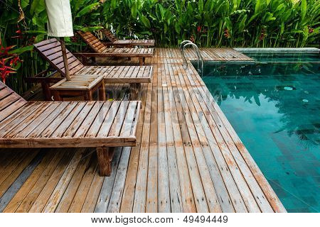 Small Swimming Pool With Wooden Setting Surrounded By Trees