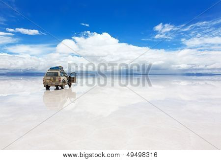 Car on the Uyuni Salar in Bolivia