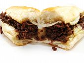 stock photo of cheesesteak  - A Philly cheesesteak sandwich on a white background - JPG