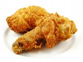pic of fried chicken  - Crispy friend chicken drumstick and thick on a white plate - JPG