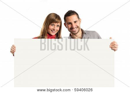 Couple Holding Placard Over White Background