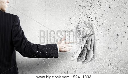 Businessman crushing stone keyboard with finger touch