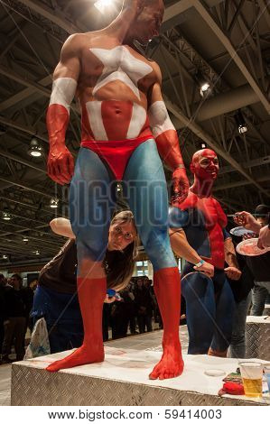 Bodybuilders During A Body Painting Session At Milano Tattoo Convention
