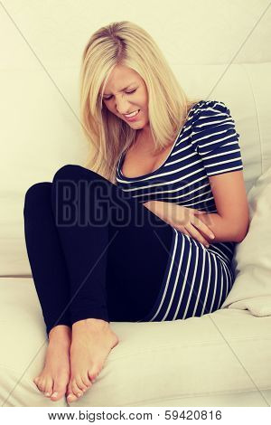 Young beautiful blond woman with stomache issues