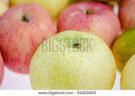 Macro shot of mix fruits isolated on white background