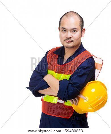 Construction site worker holding helmet