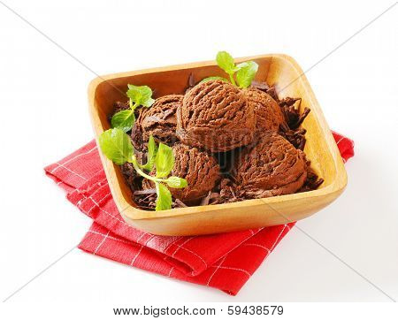chocolate sundae with chocolate flakes, served in a wooden bowl