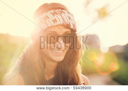 Fashion lifestyle, Beautiful young woman backlit at sunset