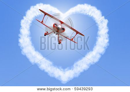 A red biplane creating a heart shaped cloud in a bright blue sky.