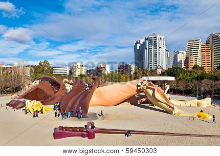 VALENCIA, SPAIN - JANUARY 14, 2014: Gulliver kids park - popular attraction with slides, ramps and ladders on 70 meters sculpture of lying Gulliver. Located in Turia Gardens in Valencia, Spain.