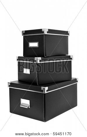 a pile of black cardboard storage boxes with metal index card holders on a white background