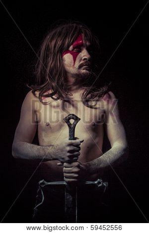 Power.savage warrior with iron sword