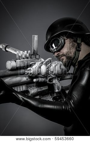 Starfighter with huge plasma rifle, fantasy concept, military helmet and goggles motorcyclist