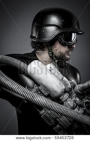 Future.Starfighter with huge plasma rifle, fantasy concept, military helmet and goggles motorcyclist