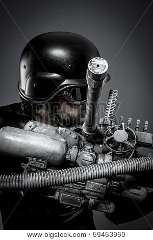 War.Starfighter with huge plasma rifle, fantasy concept, military helmet and goggles motorcyclist