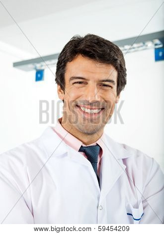 Portrait of happy male researcher in lab