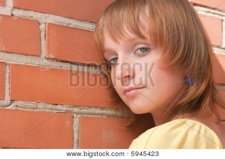 The Girl At A Brick Wall