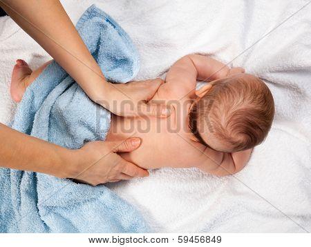Masseuse massaging 5 months infant