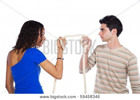 Man and woman pulling a rope competing (selective focus)
